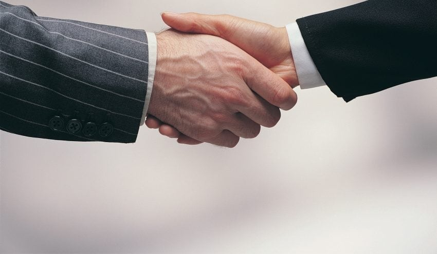 Shaking hands - bribery