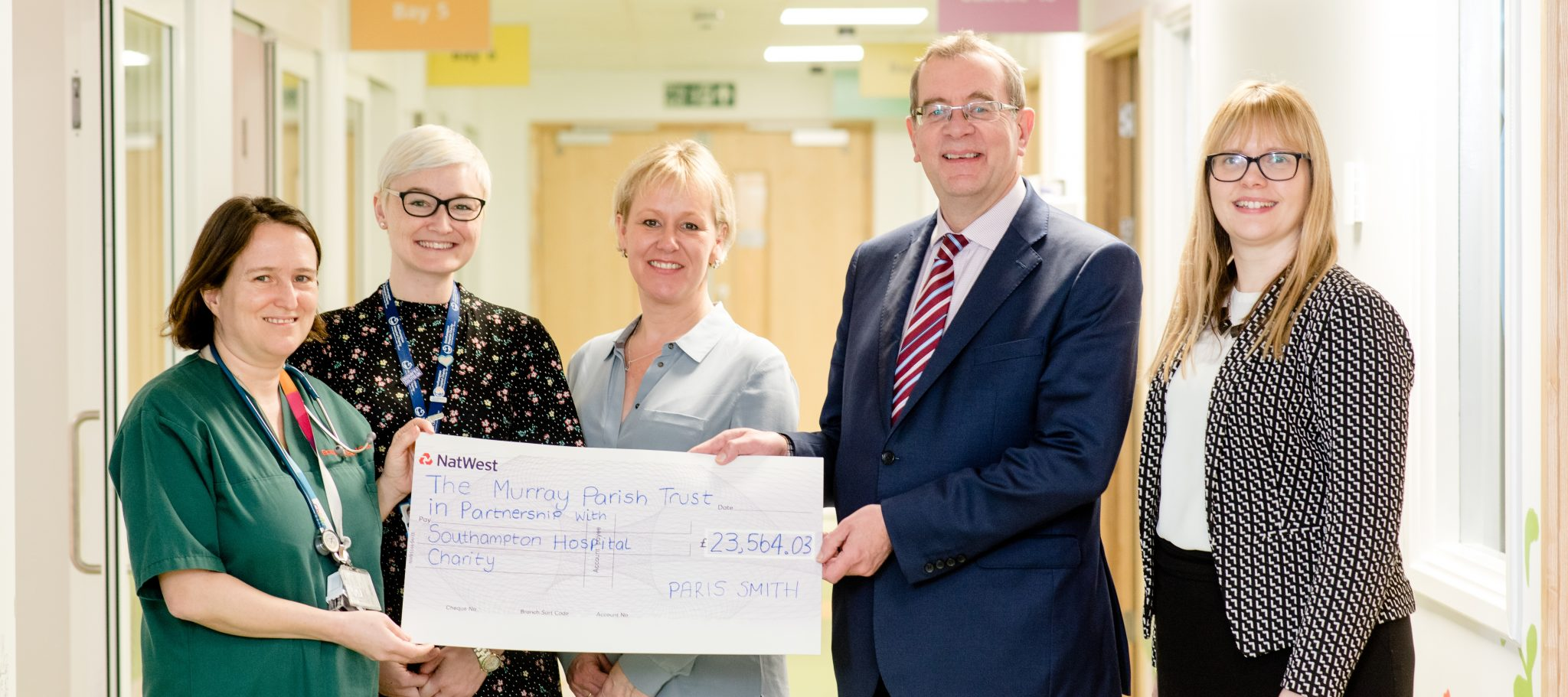 Paris Smith present cheque for over £23,500 to its Charity of the Year